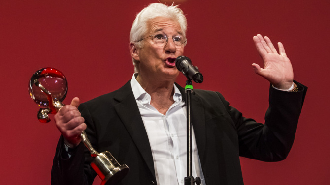 KARLOVY VARY, CZECH REPUBLIC - JULY 03:  Actor Richard Gere deliveres a speech as he receives the Crystal Globe for Outstanding Artistic Contribution to World Cinema at the opening ceremony of the 50th Karlovy Vary International Film Festival (KVIFF) on July 3, 2015 in Karlovy Vary, Czech Republic.  (Photo by Matej Divizna/Getty Images)